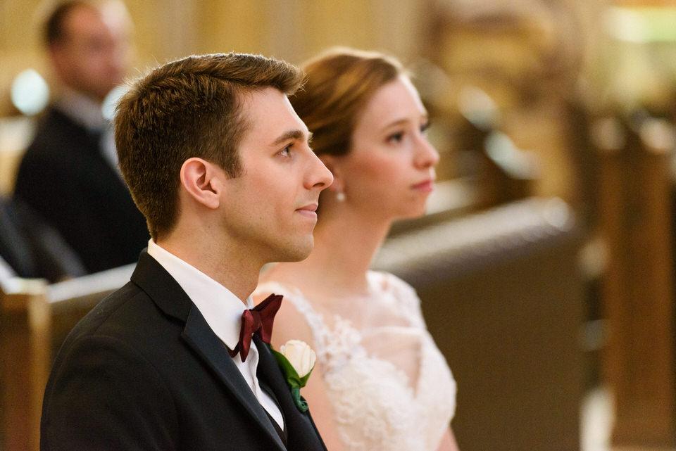 Wedding couple listening during ceremony