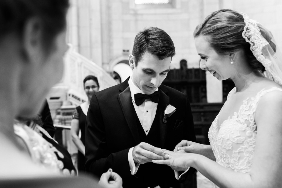 Groom putting ring on his wife
