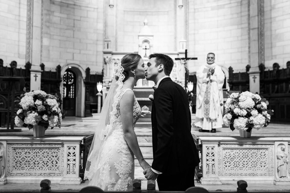 Wedding couple kissing at church