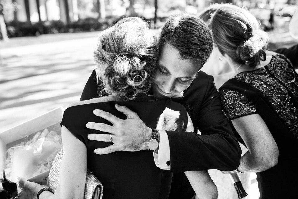 Groom hugging mom after wedding