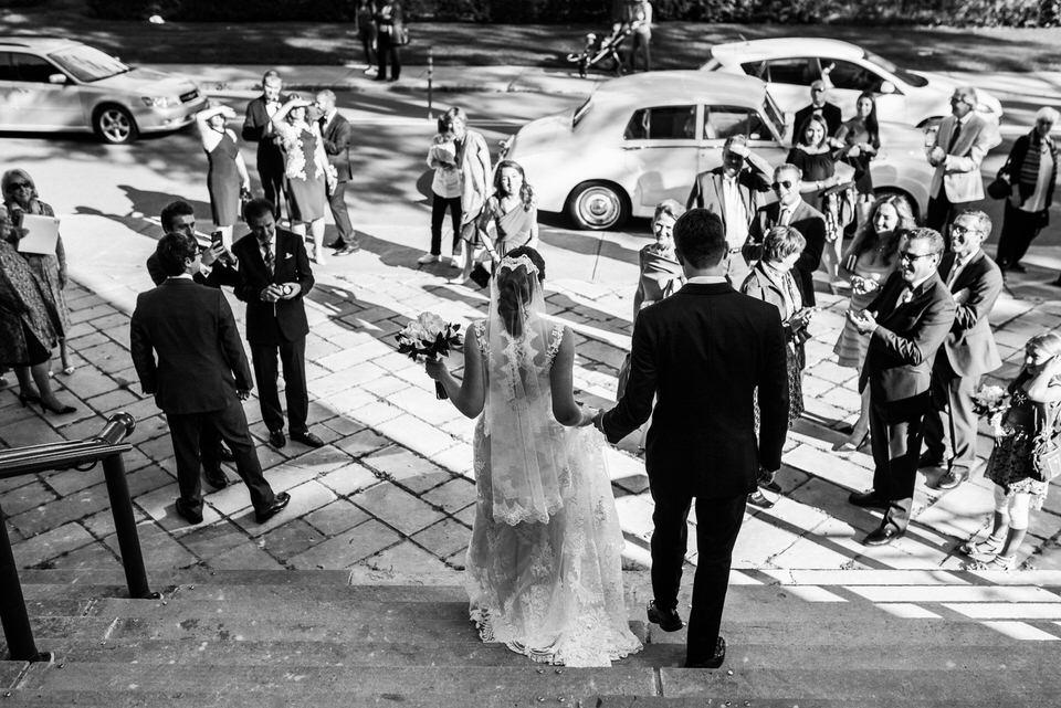 Wedding couple exiting church steps