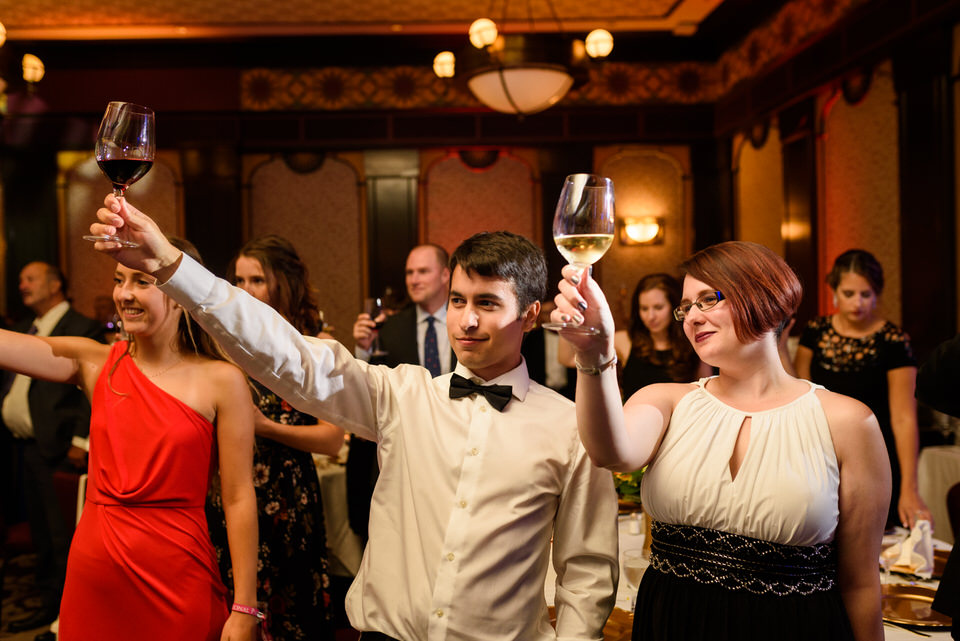 Wedding guests raising glasses in toast at Hotel Intercontinental Montreal