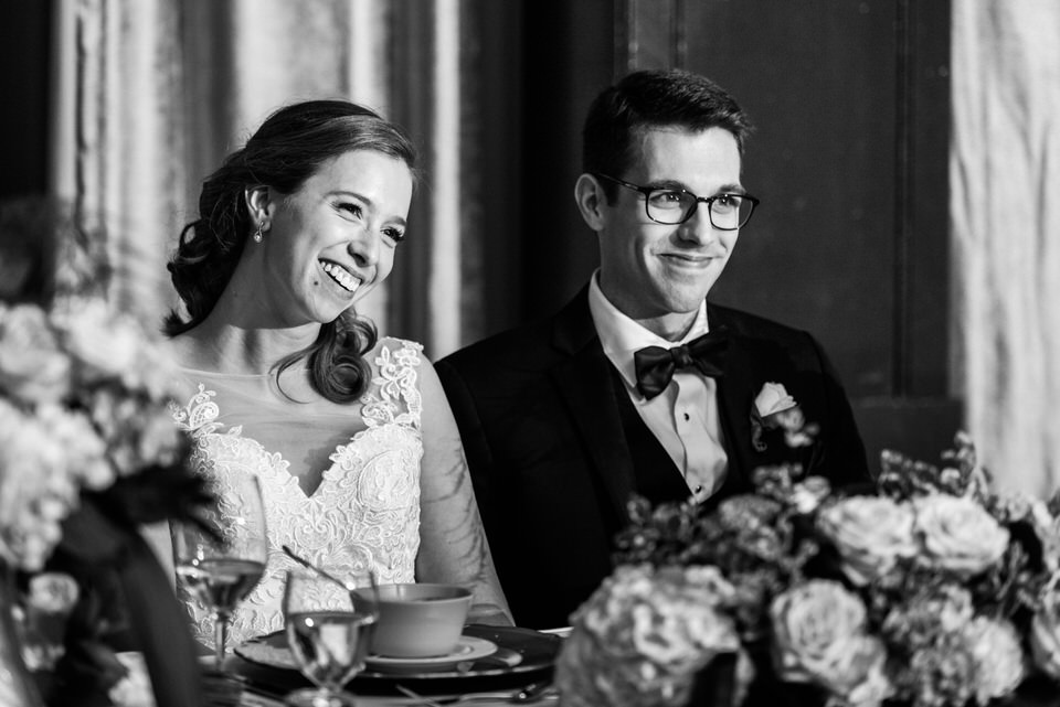 Wedding couple smiling at dinner