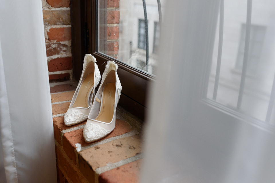 Bride's shoes on window sill