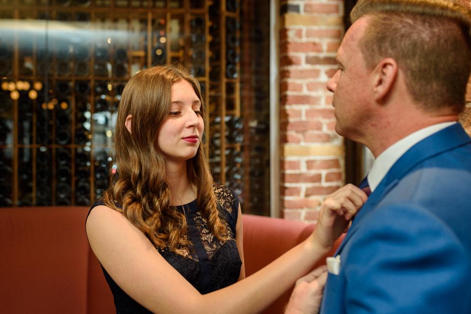 Groom's daughter fixing his tie
