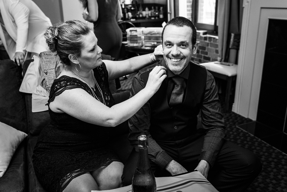 Bride's brother getting collar adjusted