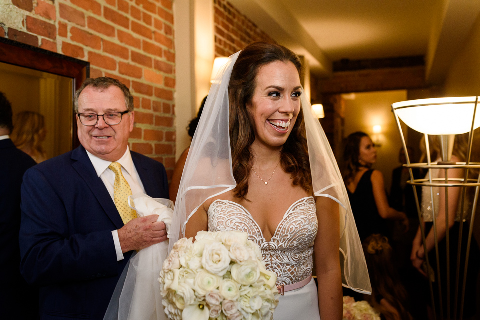 Bride and father heading downstairs at the Hotel Nelligan