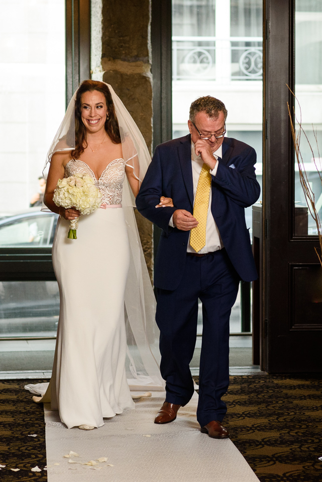 Bride and father entering Hotel Nelligan wedding ceremony