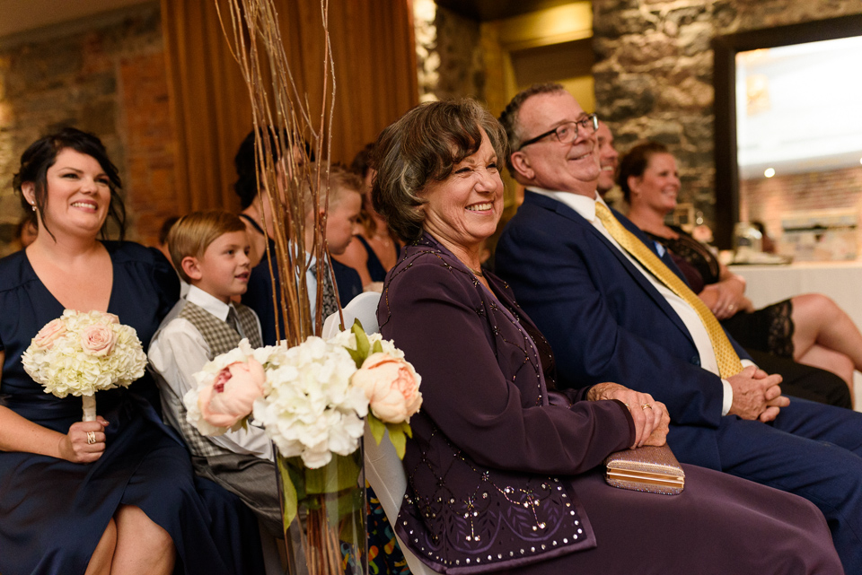 Bride's parents laughing during ceremony