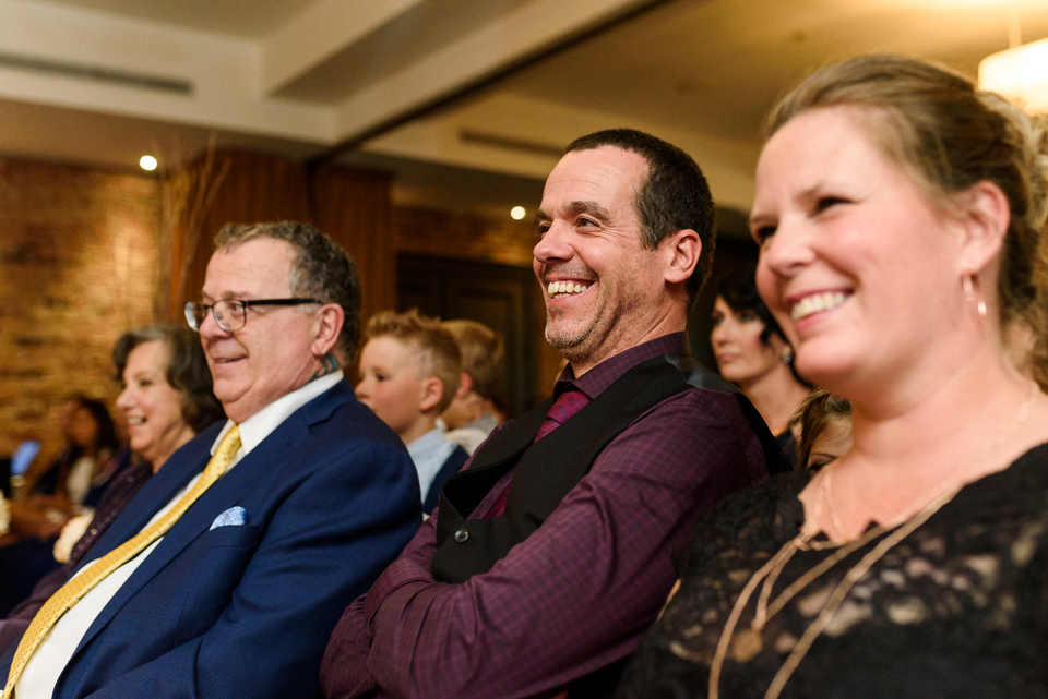 Wedding guests laughing during Hotel Nelligan wedding ceremony