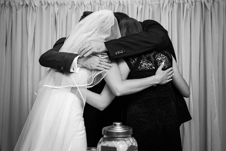 Emotional hug with family at Hotel Nelligan wedding ceremony