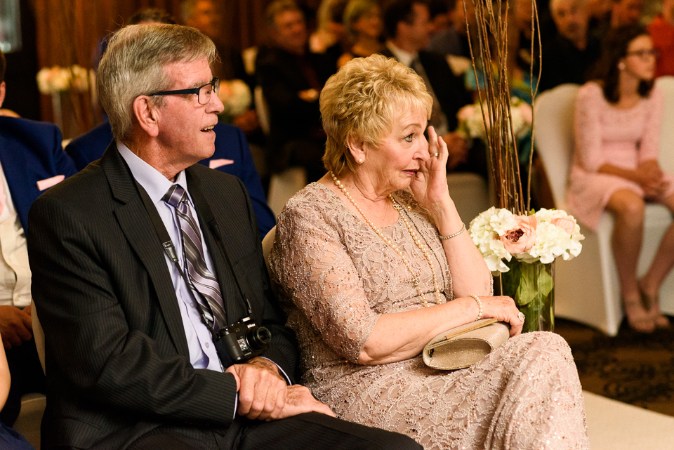 Mother of groom tearing up at wedding ceremony