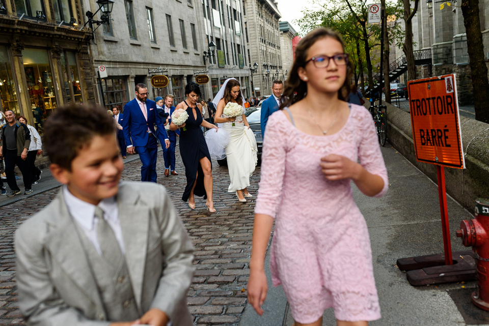 Wedding guests walking through Old Montreal