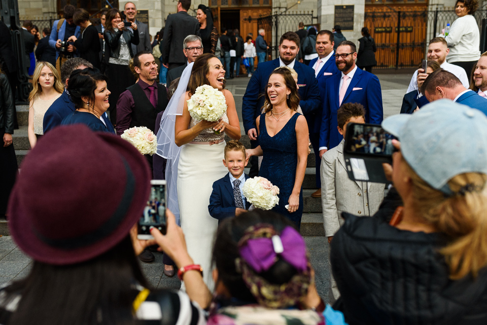 Excited tourists taking photo of bride in Old Montreal