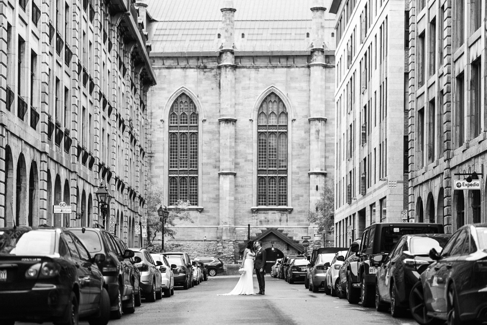 Black and white landscape portrait of wedding couple in Old Montreal