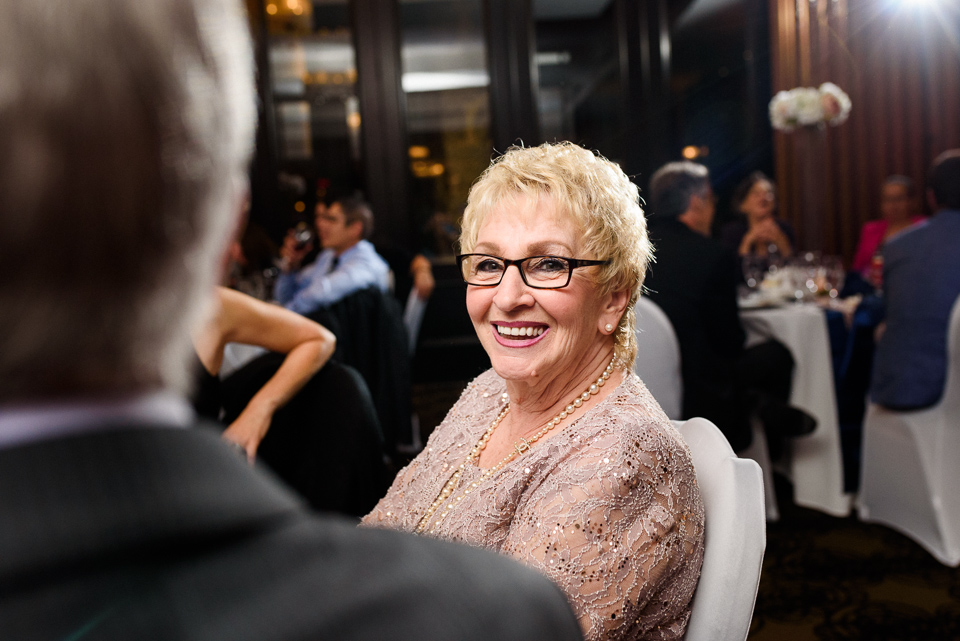 Mother groom excited at wedding reception