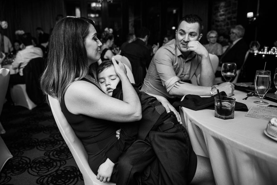 Kid sleeping at wedding dinner