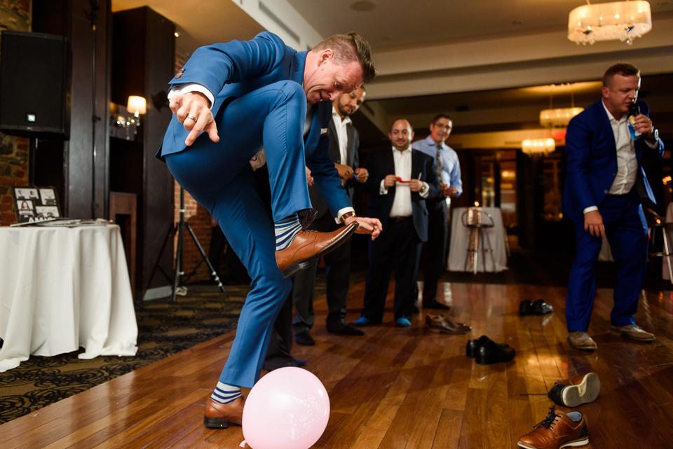 Groom stomping on balloon