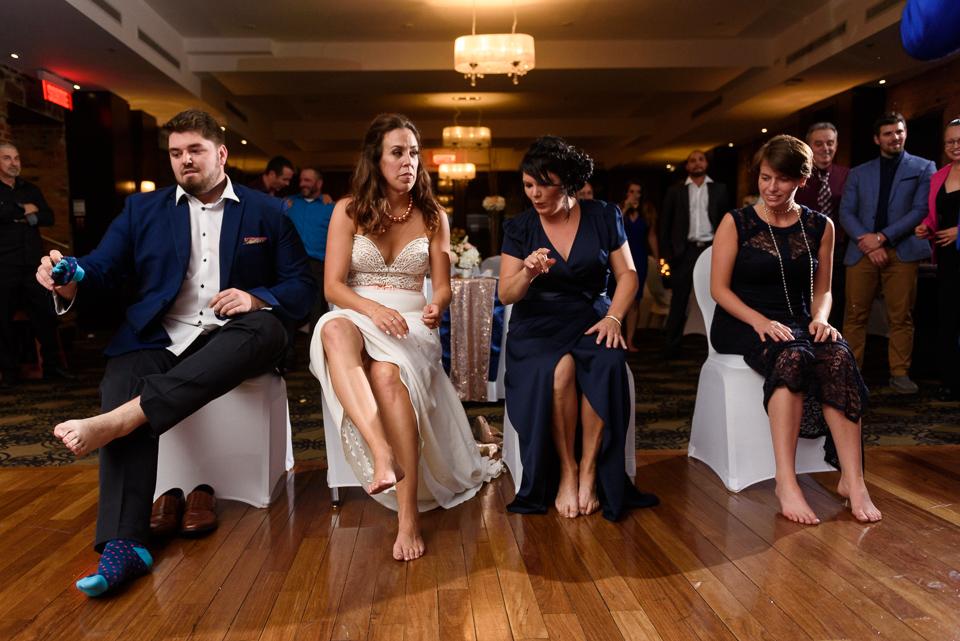 Wedding guests preparing for garter