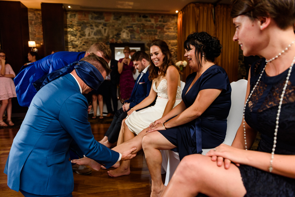 Blindfolded groom trying to find his bride
