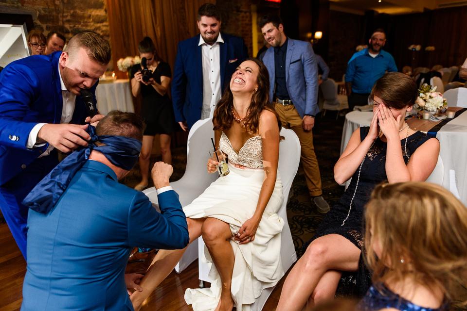 Blindfolded groom recognizes his wife's leg