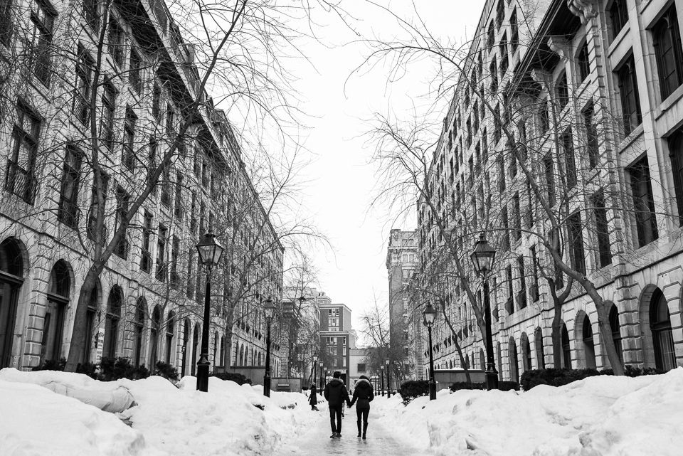 Black and white engagement photo in Old Montreal