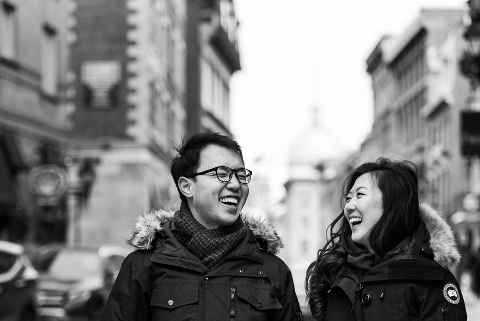 Laughing couple in winter surprise proposal photoshoot