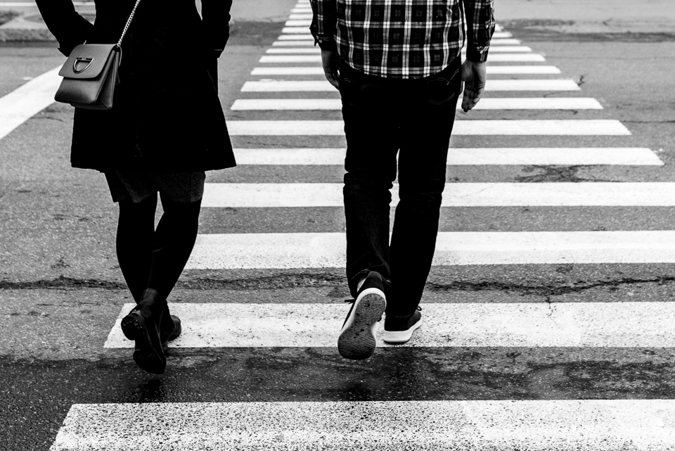 Couple walking across crosswalk