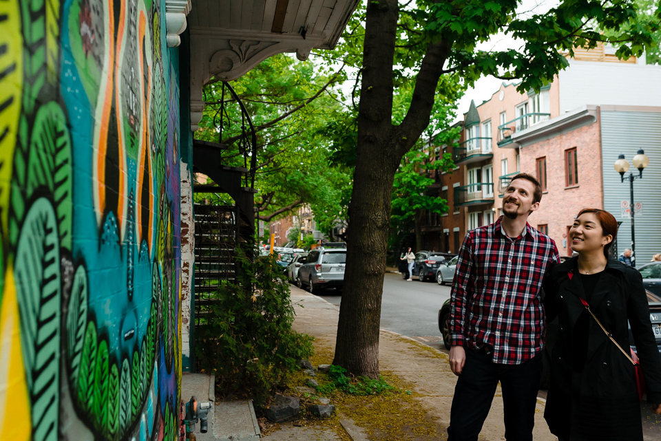 Couple enjoying graffiti walk in Mile-End Montreal