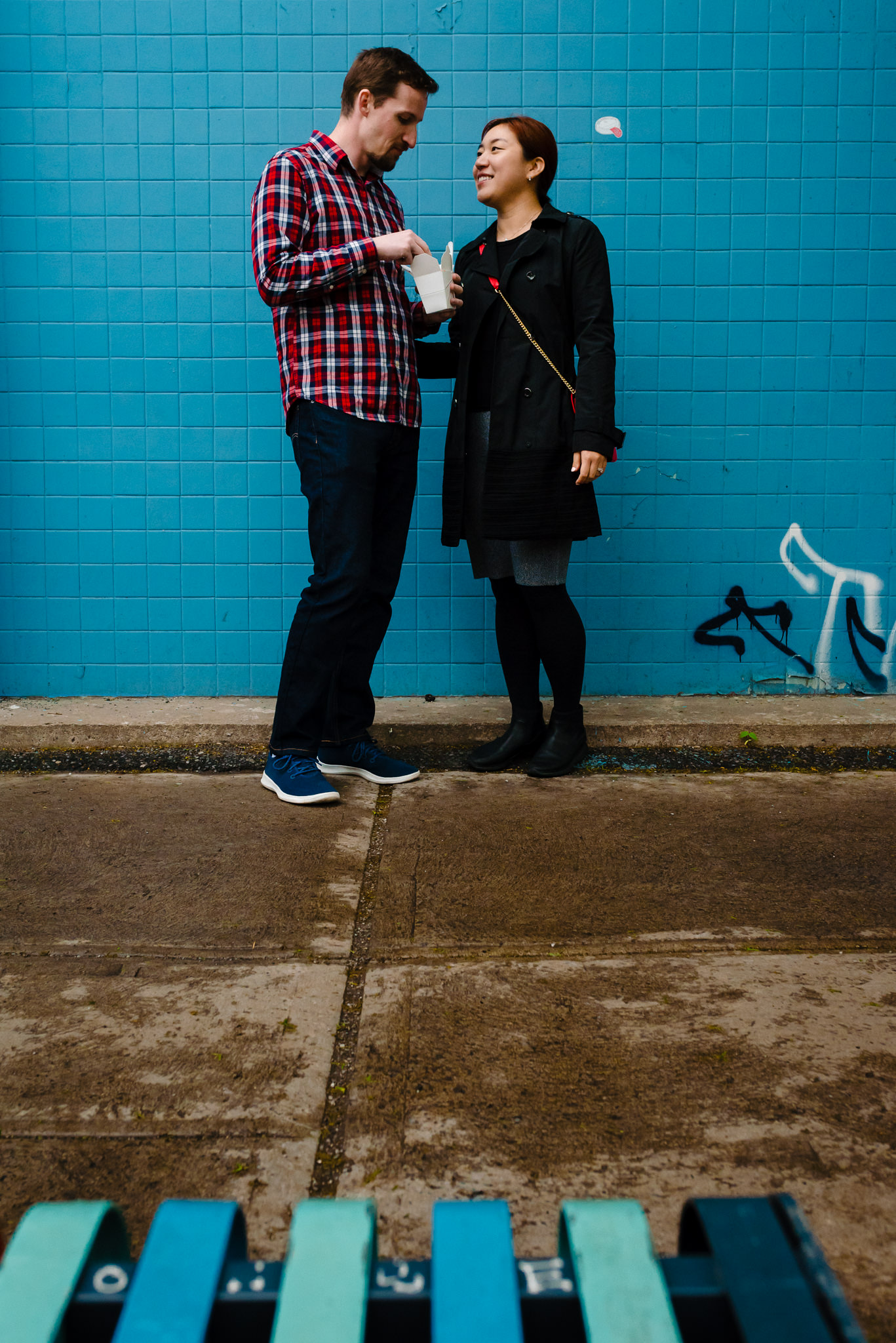 Couple vacation photo in Mile-End Montreal with blue wall