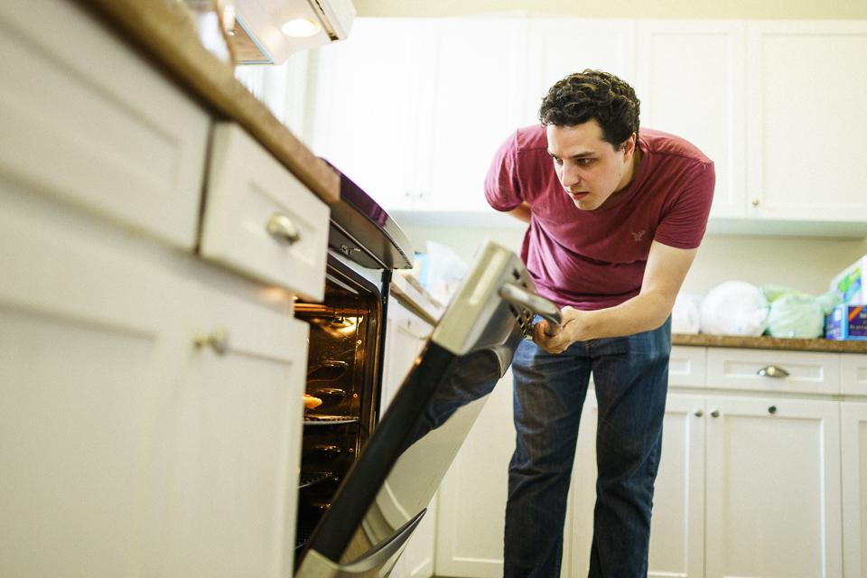 Groomsman opening oven door