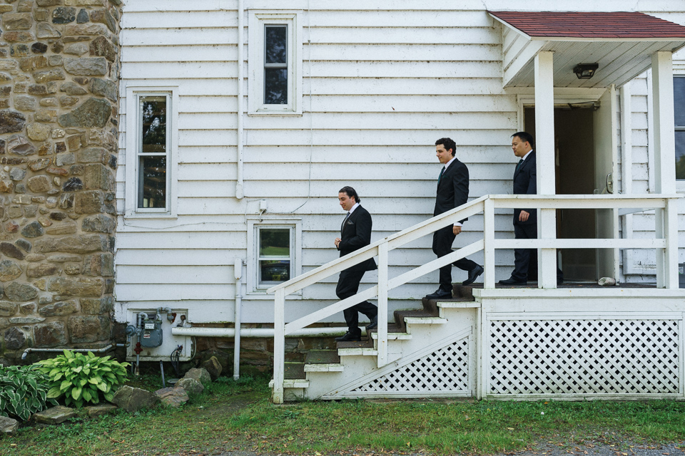 Groomsmen descending stairs