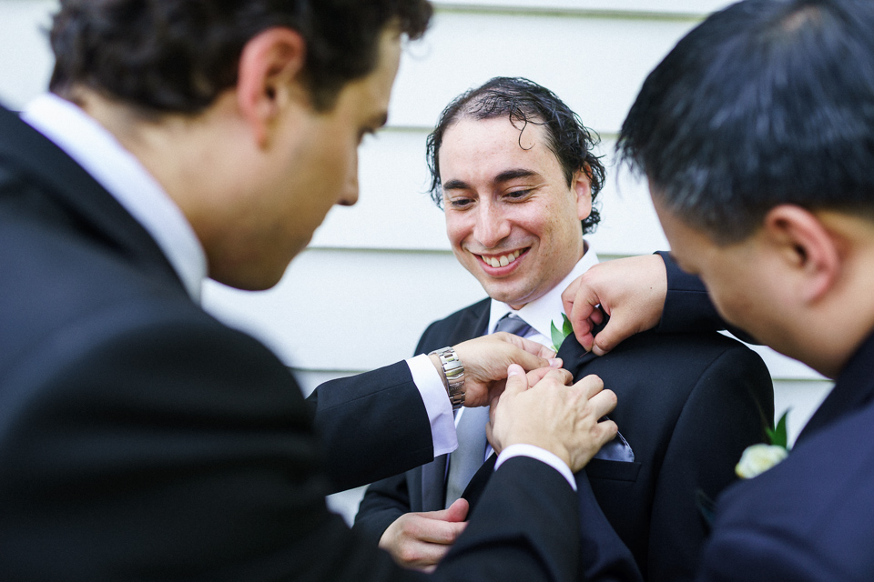Groomsmen pinning on boutonniere