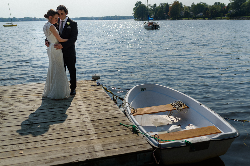 Wedding couple on a dock next to row boat