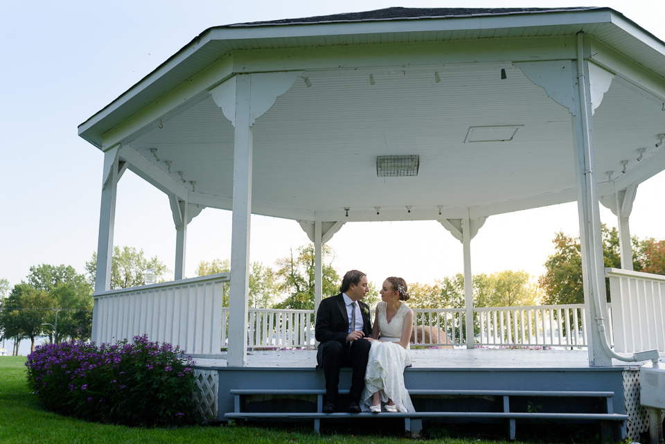 Bride and groom sitting on gazebo steps