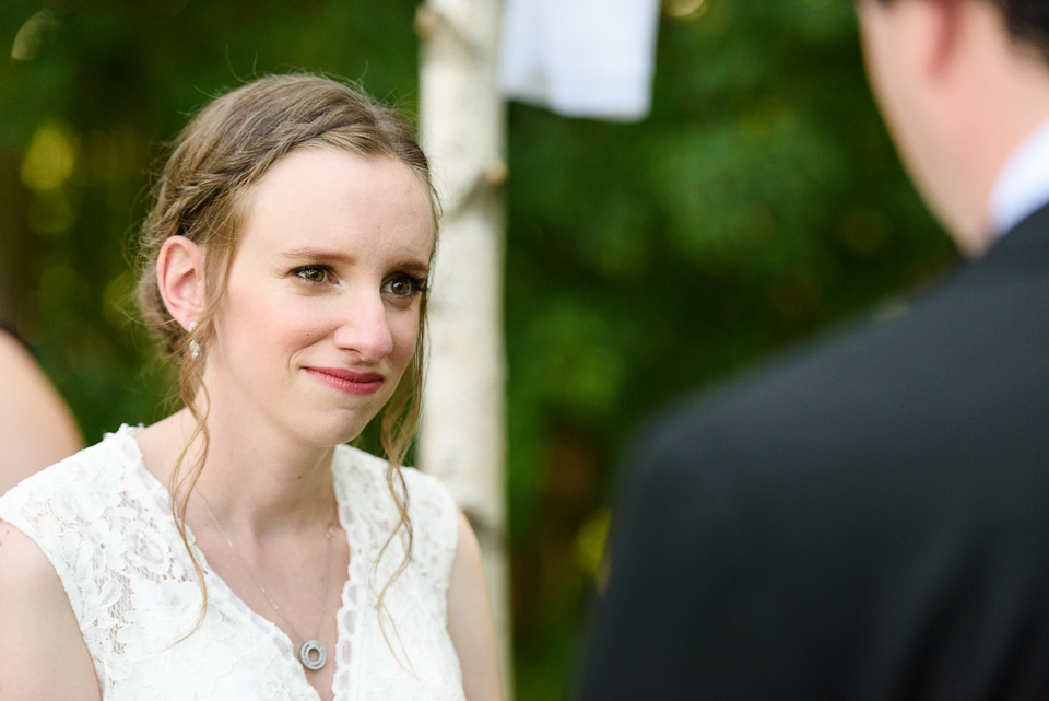 Bride looking at groom at outdoor wedding ceremony