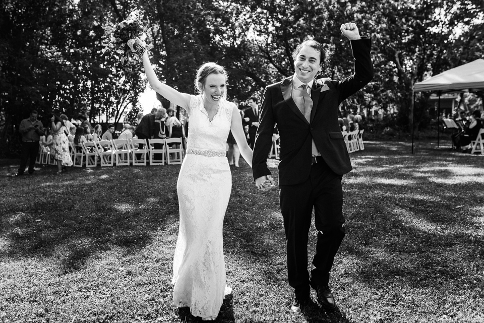 Wedding couple cheering as they were just married