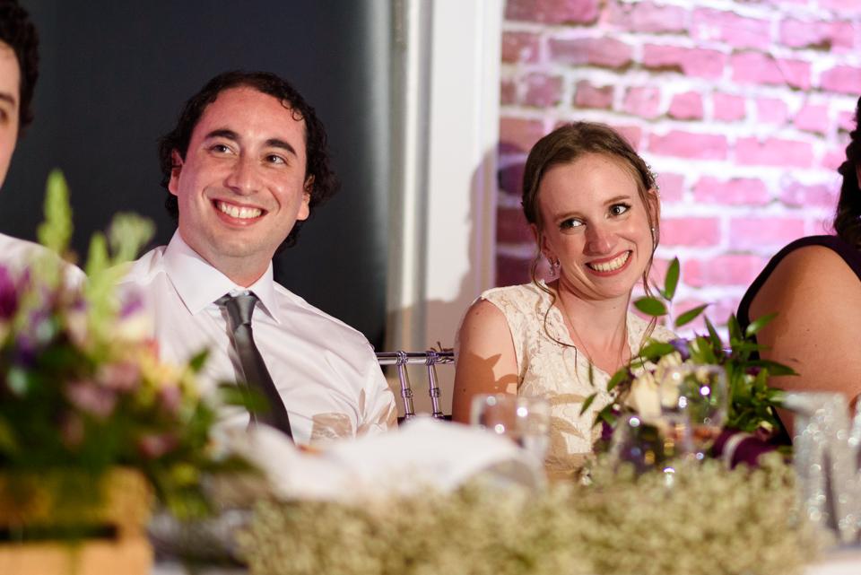 Wedding couple listening to speech
