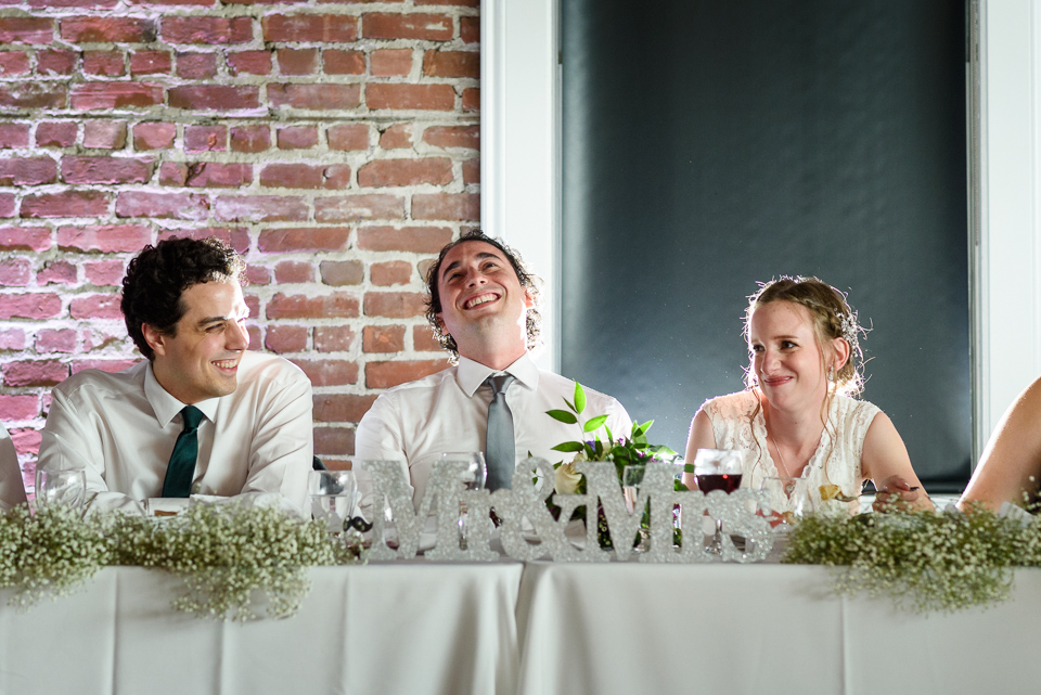 Groom laughing at speech at Canvas Montreal