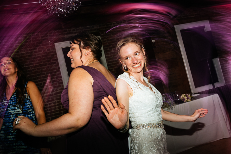 Bride dancing with bridesmaid