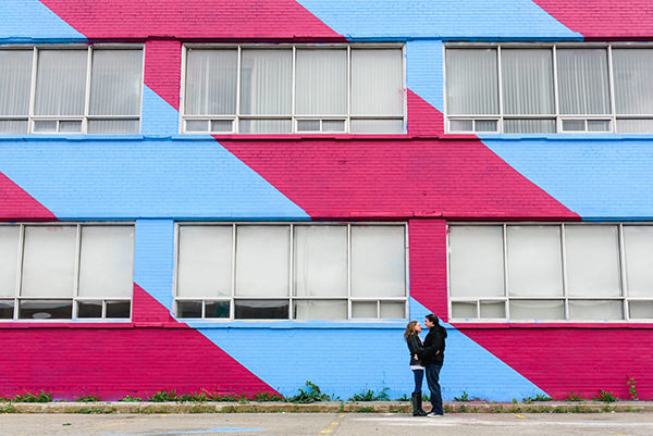 Engagement portrait at colourful striped building