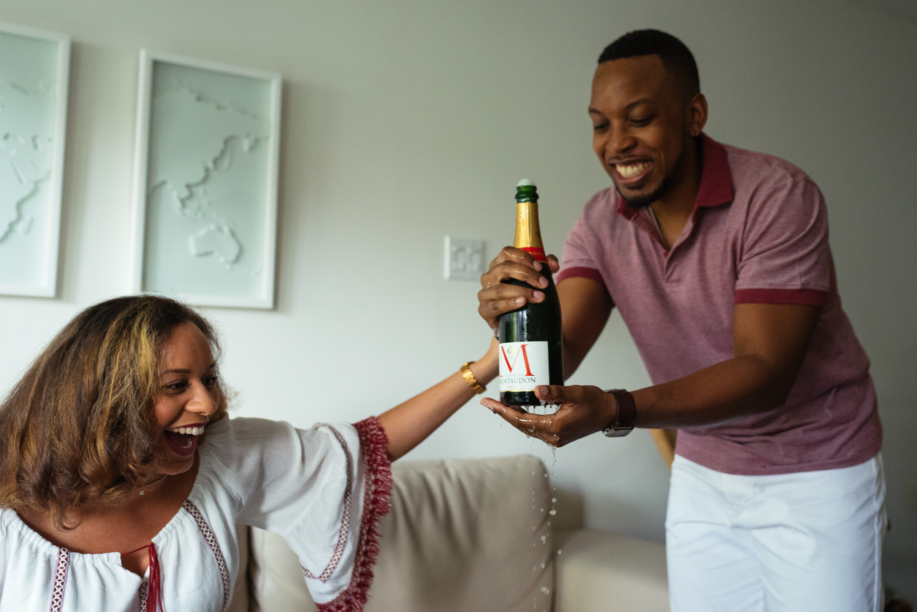 Popped champagne dripping during engagement photos