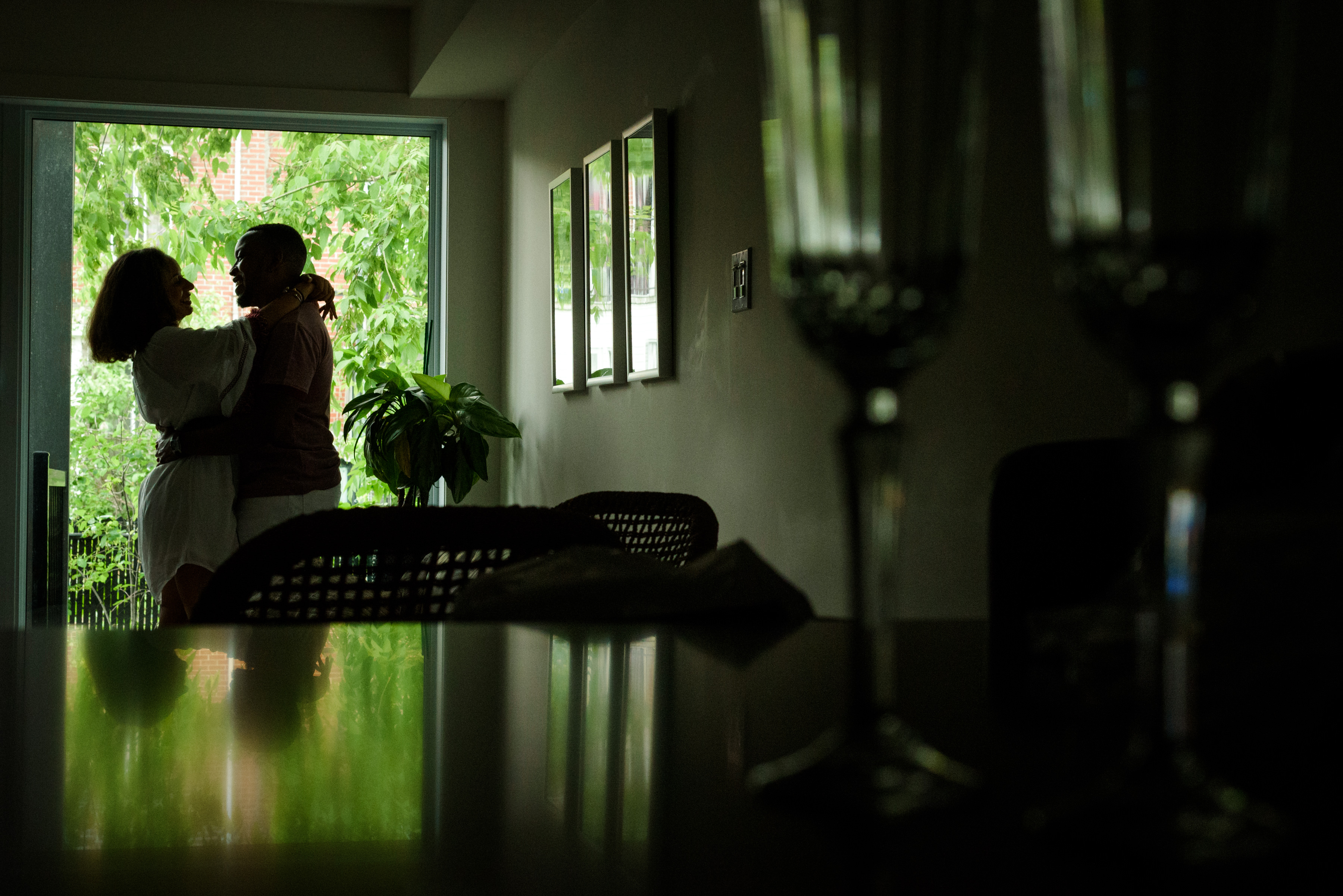 Couple silhouetted in their window