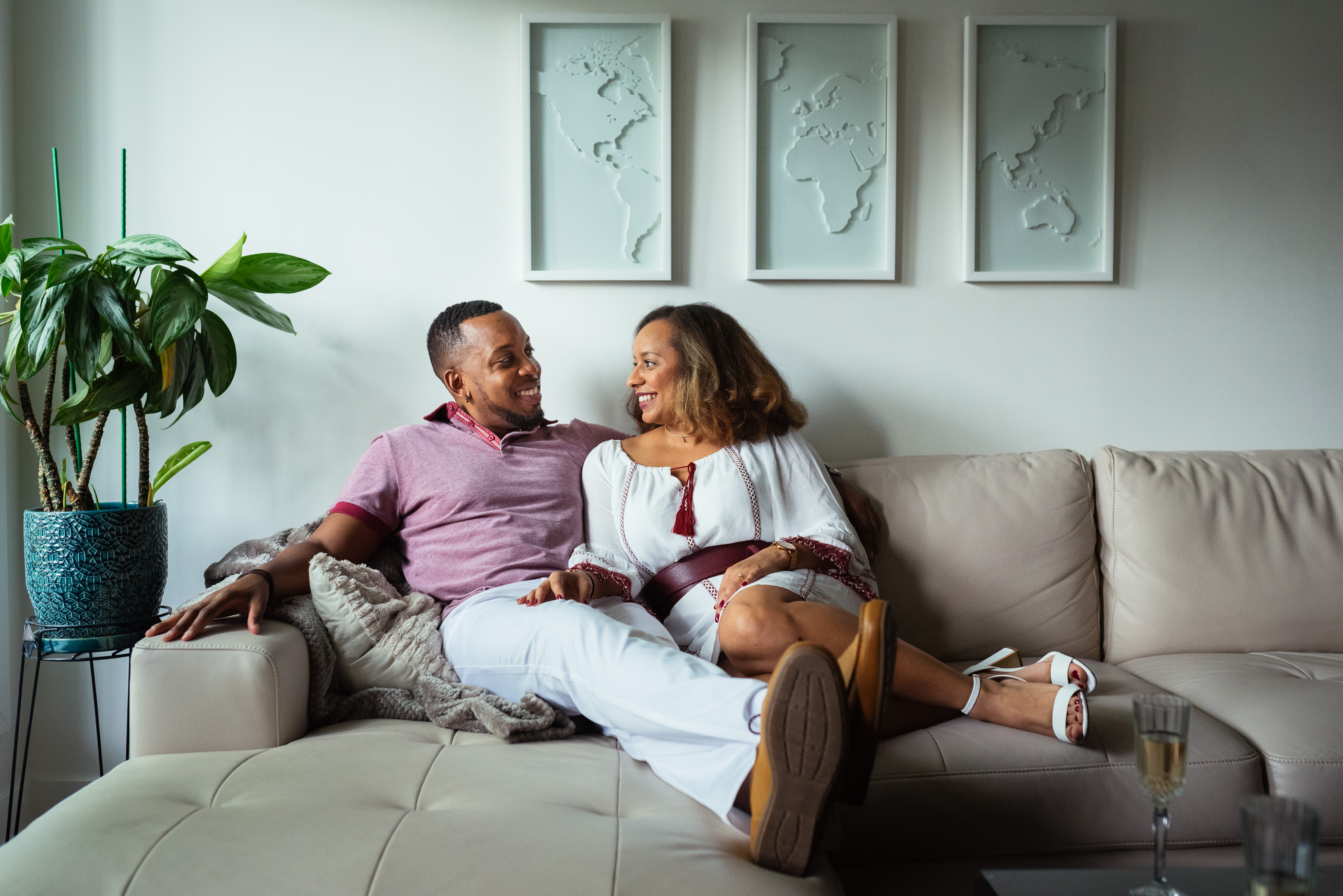 Couple sitting on their couch for at home engagement photos