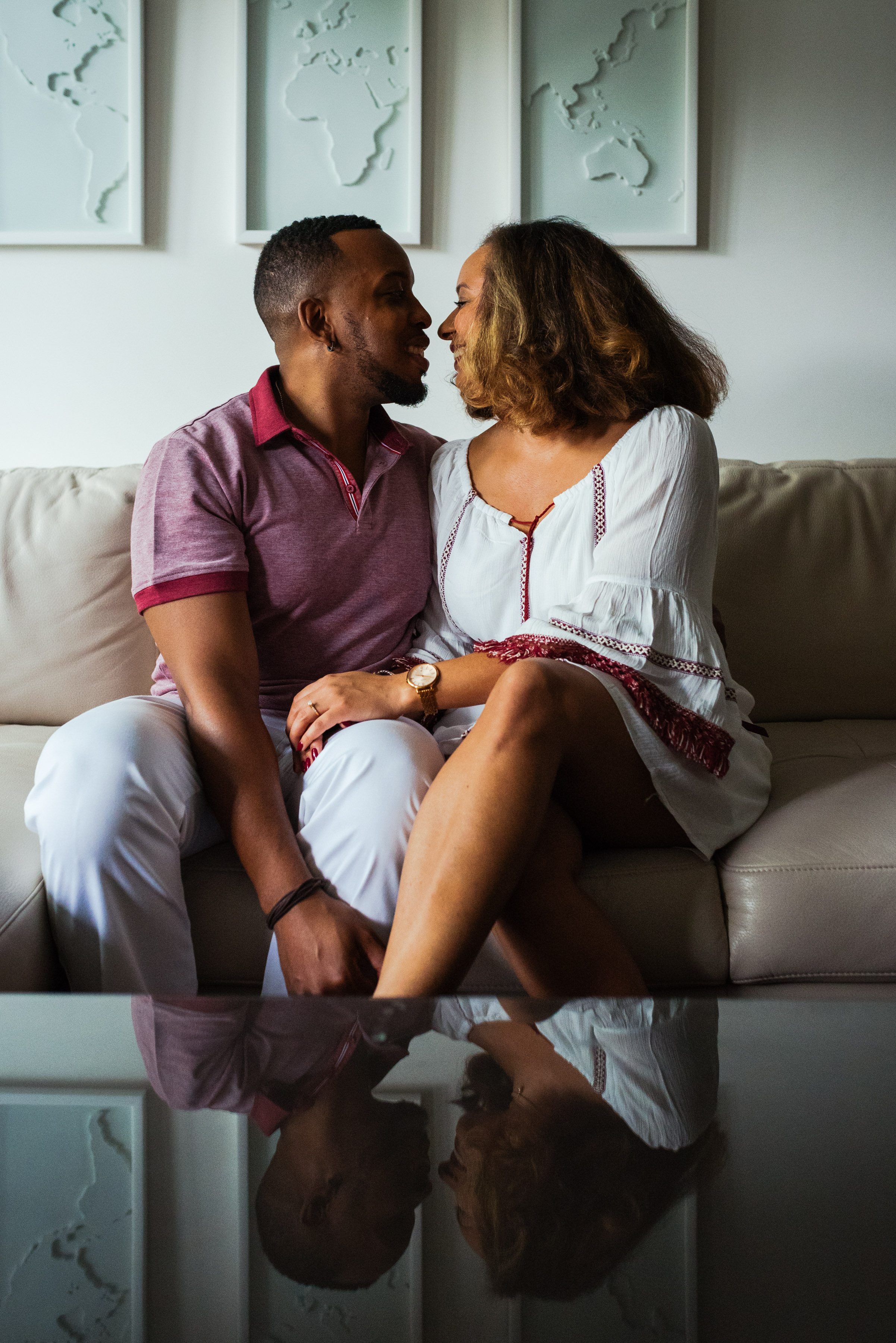 Engagement photos at home with reflection on coffeetable