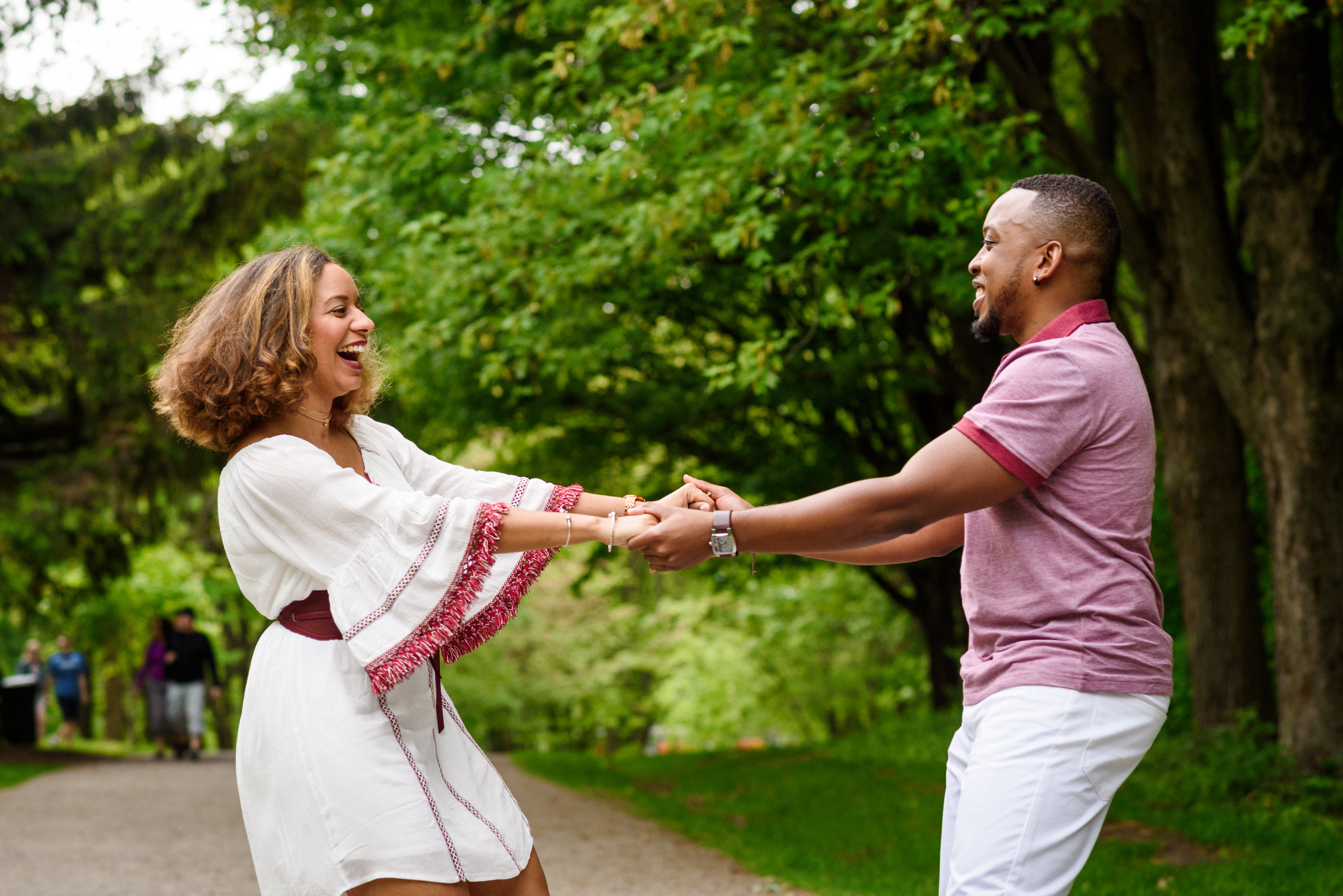 Engaged couple dancing in Mount Royal Park