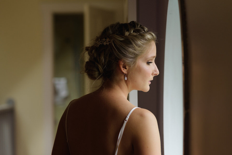 Bride looking out the window nervously