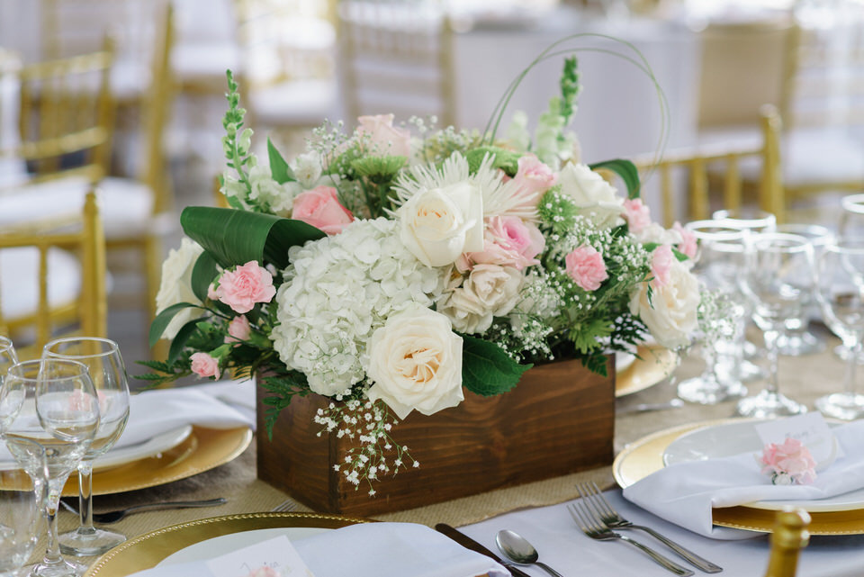 Rustic chic wedding centerpiece of flowers in a wooden box