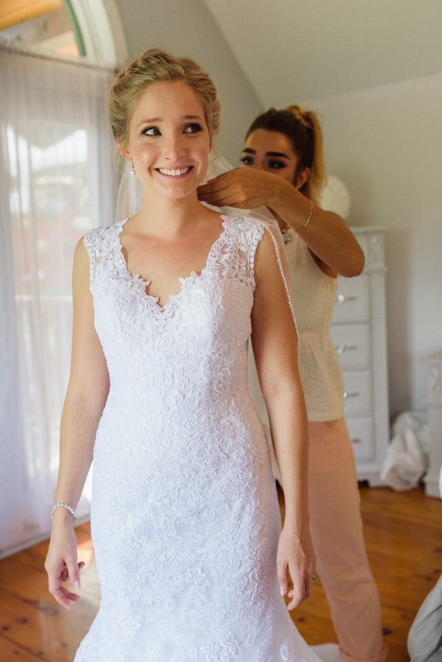 Nervous bride getting her veil pinned on