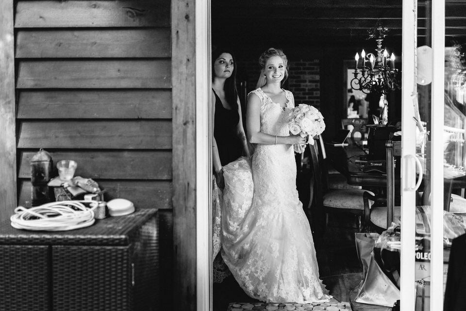 Bride peeking out doorway before wedding ceremony